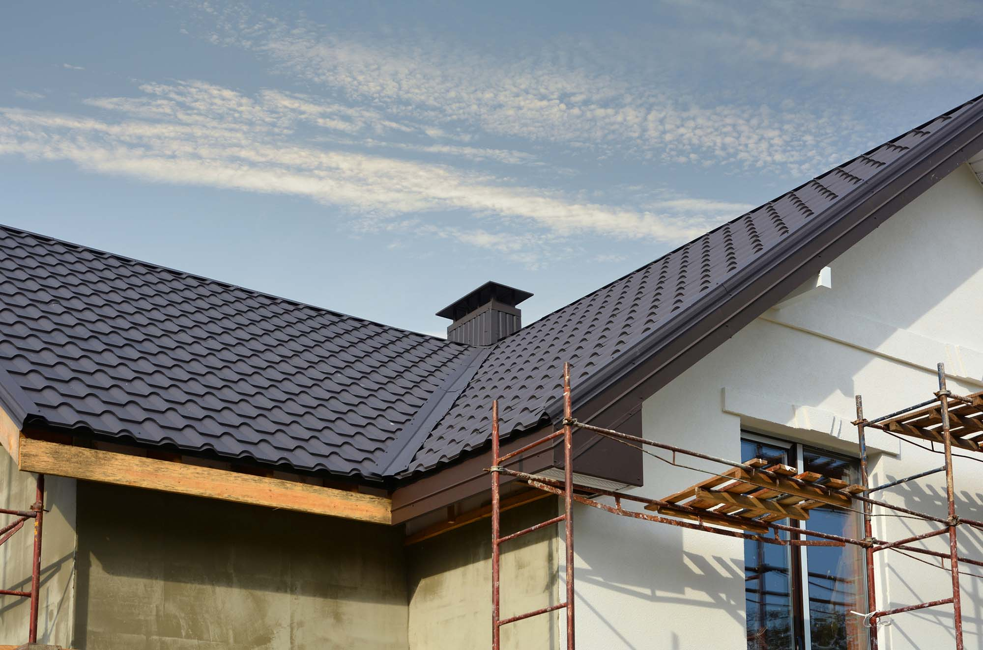 New installed grey tiles roof on home